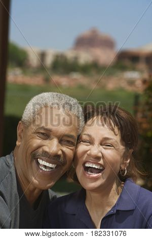 African couple hugging and laughing