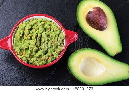 Guacamole in a bowl on a wooden