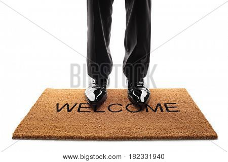 Person standing on a doormat with the word welcome written on it isolated on white background