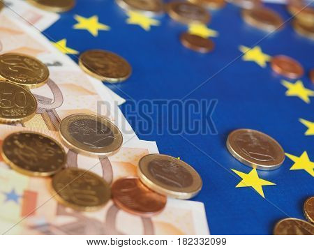 Euro Notes And Coins, European Union, Over Flag