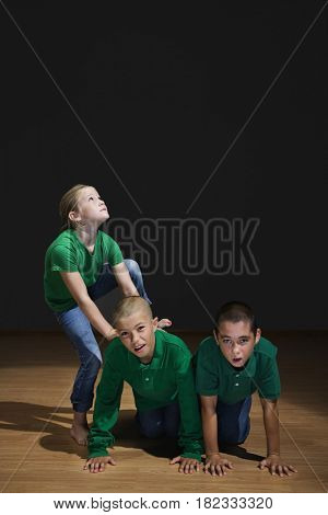 Children building human pyramid