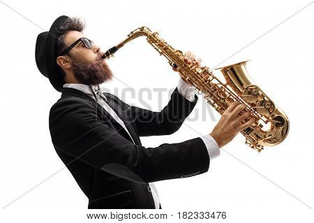 Profile shot of a man in a suit playing on a saxophone isolated on white background