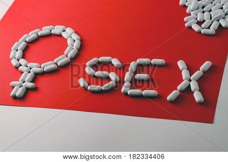 The Word Sex From Capsules And Tablets. Birth Control, Protection. Female