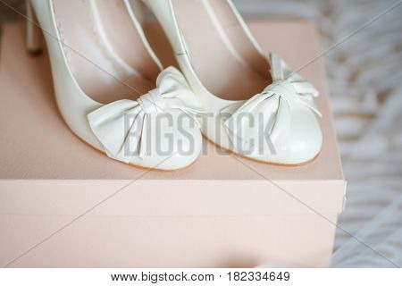 a pair of white elegant wedding shoes on a box