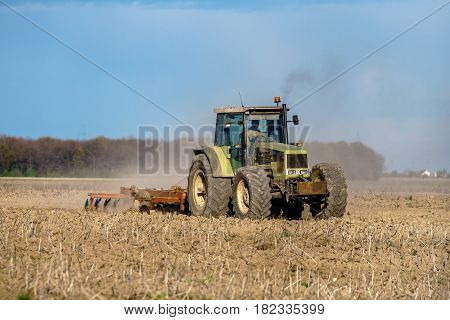Tractor Harrowing The Land