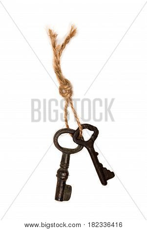 Bunch of old keys on a rope on white