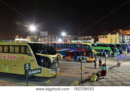 AREQUIPA PERU - AUGUST 25: Row of buses of different companies waiting in Arequipa bus station on August 25 2016 in Arequipa Peru South America.