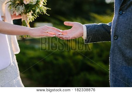 Close up hands of young married couple holding hands