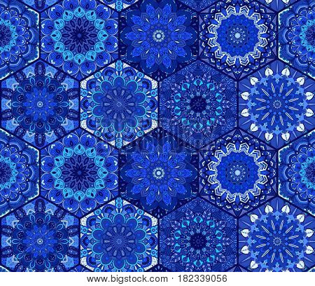 Blue tile seamless pattern. Luxury floral patchwork background. Mandala boho decoration. Intricate flower ornament. Hexagon design elements. Portuguese moroccan motif. Unusual oriental flourish print.