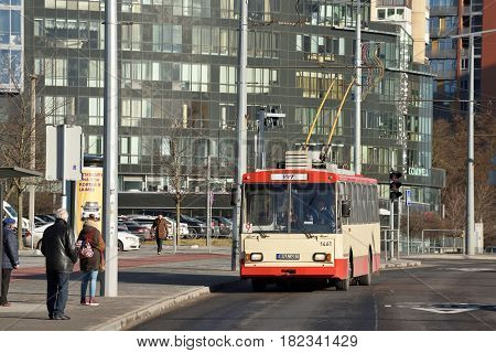 VILNIUS MARCH 16: Vilnius trolley rides along a busy street on March 16 2017 in Vilnius Lithuania. Vilnius is the capital of Lithuania and its largest city.