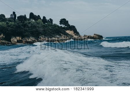 Aerial Top View Of Sea Waves Hitting Rocks On The Beach In Montenegro