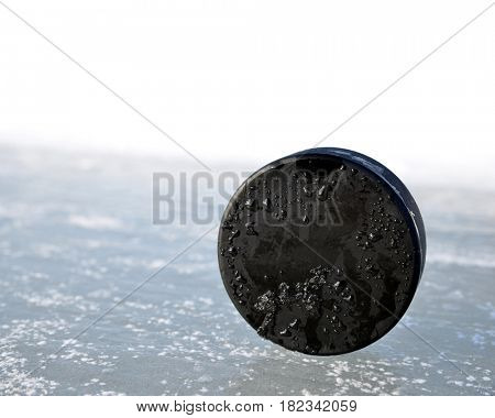 Hockey puck on a ice rink.