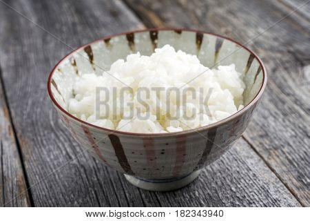 Traditional Japanese Koshihikari Rice as close-up in a bowl