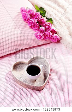 cup of coffee and pink roses in bed - food and drink