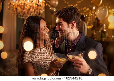 Couple Make Toast At Camera As They Celebrate At Party