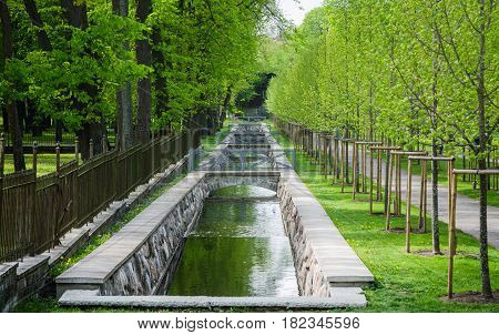 TALLINN ESTONIA - MAY 15: Picturesque water canal in spring time Kadriorg park on May 15 2016 in Tallinn Estonia.