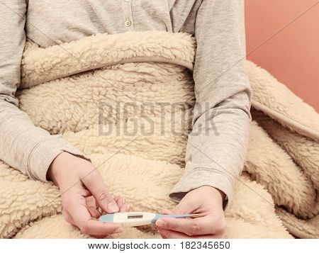 Closeup Of Sick Ill Human With Digital Thermometer