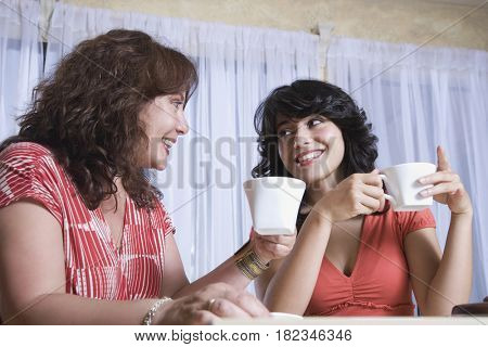 Mother and daughter enjoying coffee together