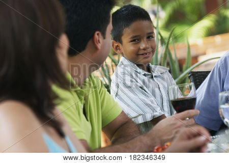 Hispanic boy smiling with family