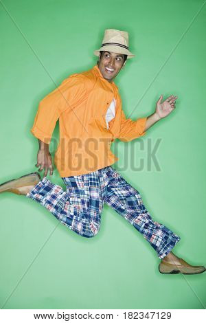 Hispanic man jumping in mid-air