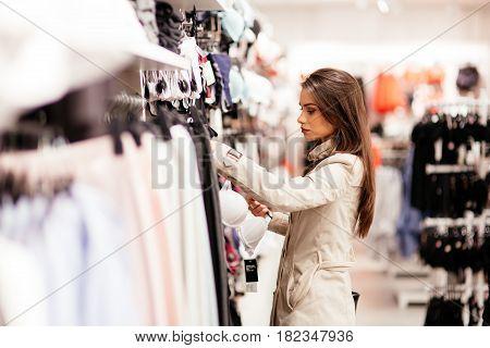 Beautiful pretty young woman shopping sexy lingerie