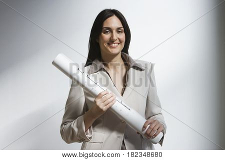 Middle Eastern businesswoman holding blueprints