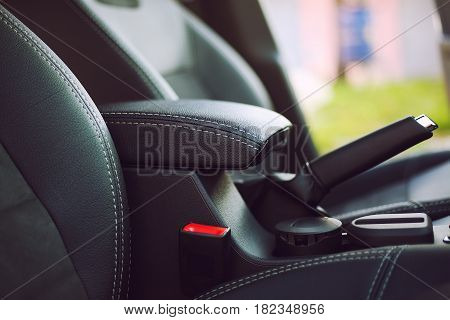 armrest in the luxury passenger car detail in the interior