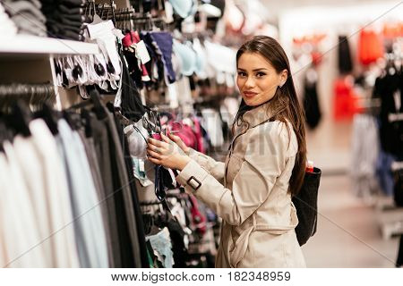 Beautiful young woman shopping sexy lingerie in shop