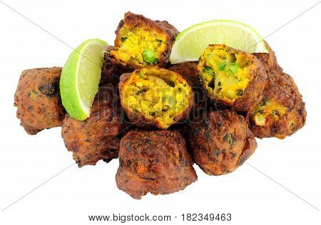 Group of fried vegetable pakora with chilli sauce dip isolated on a white background