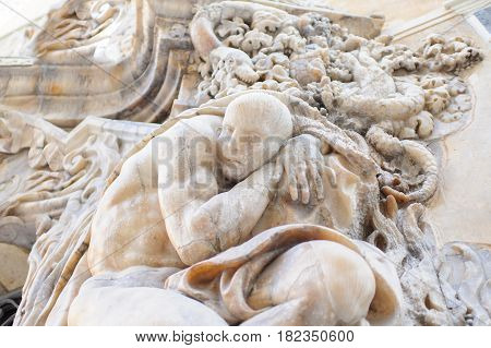 Spain, an ancient bas-relief in the city of Valencia sun