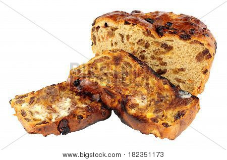 Toasted Irish barmbrack sweet bread slices with butter isolated on a white background