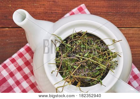 Dried Thyme In Teapot