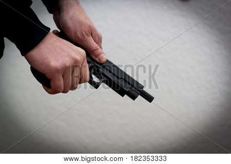 Killer pistol for killing pulls cartridge into the chamber crime mafia kidnapping