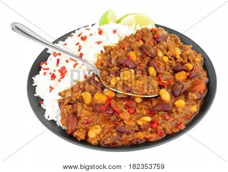 Chilli Con Carne with boiled rice on a black plate isolated on a white background