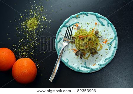 Dish of Spaghetti with pistachios. Typical Sicilian cuisine, the tradition of the Mediterranean diet