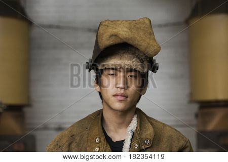Japanese welder looking serious