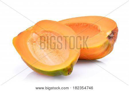 half of fresh papaya seedless isolated on white background