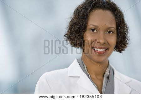 African doctor in lab coat