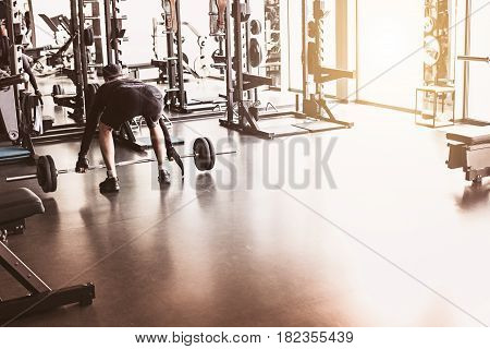 The abstract blur fitness gym background at sunny day with fit man