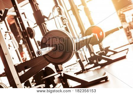 The abstract blur fitness gym background at sunny day