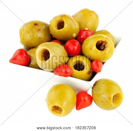 Dish of green gordal olives and sweet red piquante chilli peppers isolated on a white background