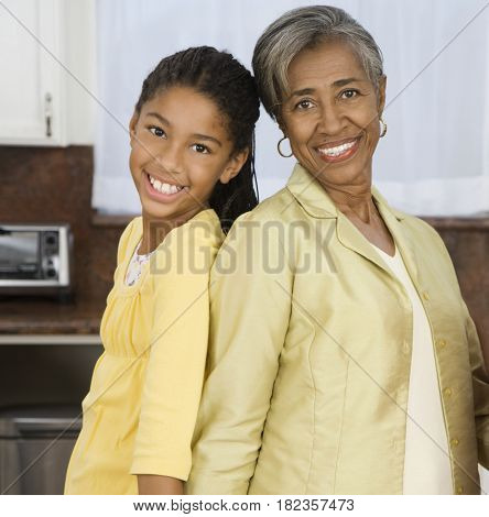 African grandmother and granddaughter smiling