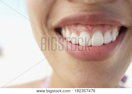 Close up of Asian woman's smiling mouth