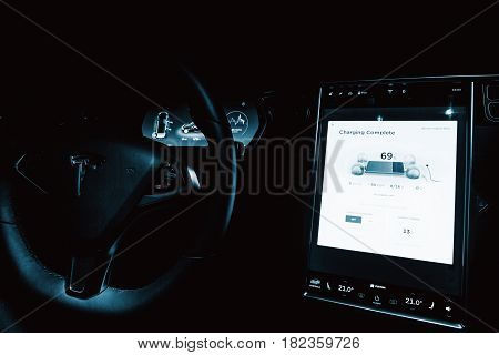 RALSKO CZECH REPUBLIC - OCTOBER 22 2016: Interior of Tesla Model S 90D car. SW-board computer TESLA car detail the new software on display. Tesla Motors is an American company. Blue colored.