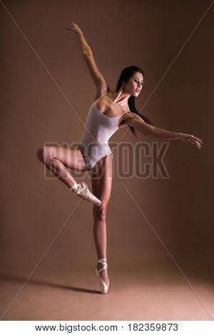 Beautiful Woman Ballet Dancer Dancing Over Beige