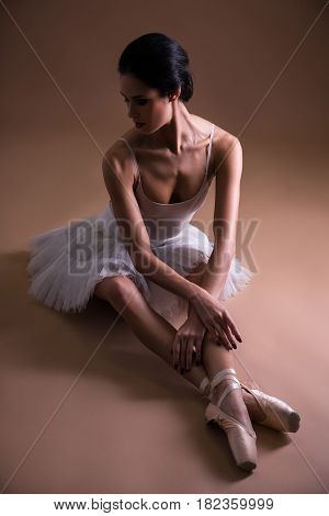 Young Beautiful Woman Ballet Dancer In Tutu Sitting