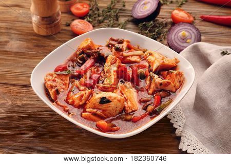 Plate with chicken cacciatore on kitchen table