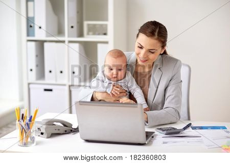 business, motherhood, multi-tasking, family and people concept - happy smiling businesswoman with baby and laptop computer working at office