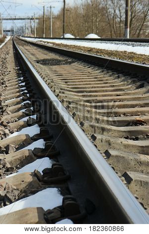 perspective, rails of railway go into distance