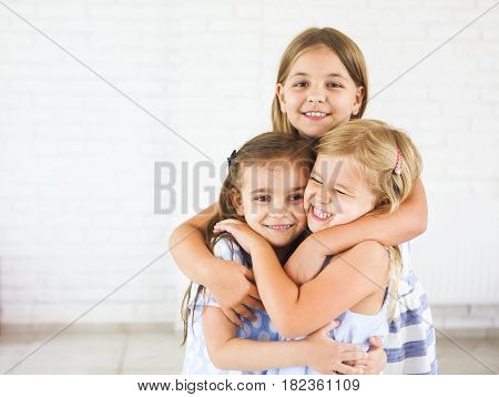 Happy funny girls embrace together. Friendship concept